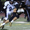 Peabody: Bishop Fenwick's Tom Parsons holds onto the ball while diving forward after catching a slant pass from senior quarterback Nick Bona on Friday evening. David Le/Salem News