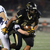 Peabody: Bishop Fenwick's Rufus Rushins plows through a North Shore Tech defender on his way towards the end zone on Friday evening. David Le/Salem News