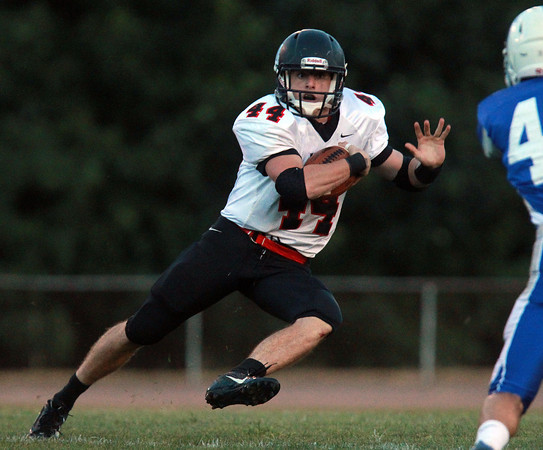 Danvers: Marblehead junior running back Brooks Tyrrell makes a cut and looks for running room against Danvers on Friday evening. Tyrrell rushed for over a hundred yards and two touchdowns, leading the Magicians to a 44-0 win over the Falcons. David Le/Salem News