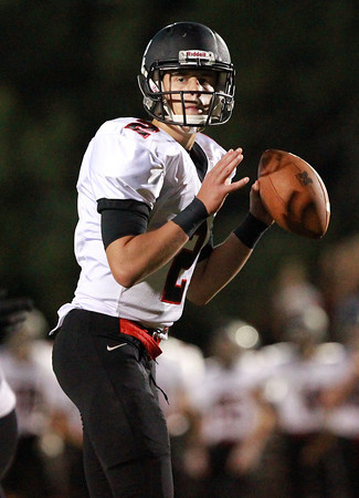 Danvers: Marblehead senior quarterback Matt Millett drops back to pass and throws a strike to classmate Brian Daly for a touchdown. David Le/Salem News