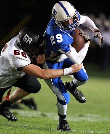 Danvers: Danvers freshman wide receiver Matt Andreas tries to escape the grasp of Marblehead junior Dan Marino, on Friday evening. David Le/Salem News