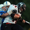 Danvers: Marblehead junior running back Brooks Tyrrell tries to keep his balance while being dragged down by Danvers junior Joe O'Donnell. David Le/Salem News