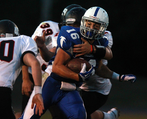 Danvers: Danvers senior captain Anthony Cordoba holds on to the football tightly and braces for a hit from a Marblehead defender on Friday evening. David Le/Salem News