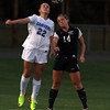 Danvers: Danvers junior Becca Horn (22) and Swampscott senior Leah Dawley battle for a header on Thursday evening. David Le/Salem News