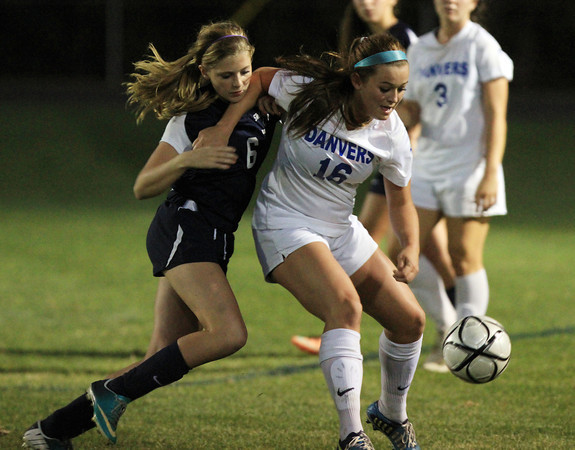 Danvers: Danvers junior Shannon Pohle (16) shields the ball from Swampscott freshman Bridget Cullinnane (6) during the first half of play on Thursday evening. Pohle scored a second half hat trick to lead the Falcons over the Big Blue 7-0. David Le/Salem News