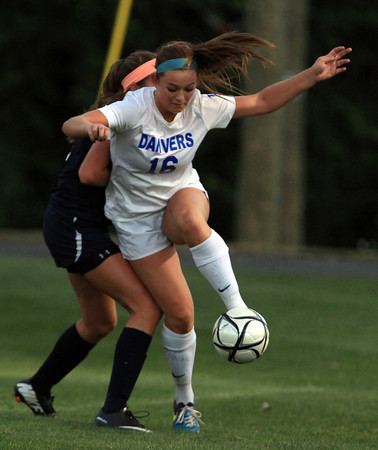 Danvers: Danvers junior forward Shannon Pohle controls the ball against Swampscott on Thursday evening. Pohle notched a second half hat trick to lead the Falcons to a 7-0 win over the Big Blue. David Le/Salem News