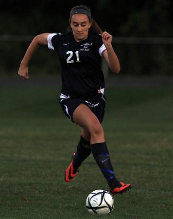 Danvers: Swampscott sophomore Emma Wright carries the ball upfield against Danvers on Thursday evening. David Le/Salem News