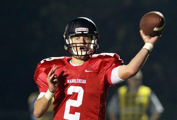 Marblehead: Marblehead senior quarterback Matt Millett rifles a completion to senior teammate Dylan Cressy for a short gain on Thursday evening. David Le/Salem News
