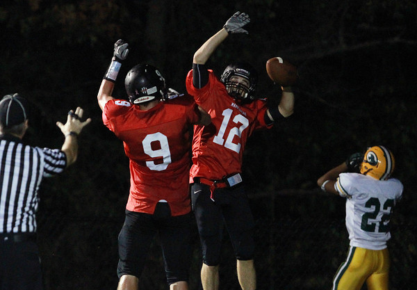 Marblehead: Marblehead senior Brian Daly (12) celebrates the first of his long touchdowns with teammate Will Millett (9) after Daly beat Lynn Classical's Kenny Khun down the sideline and hauled in a pass from senior quarterback Matt Millett. David Le/Salem News