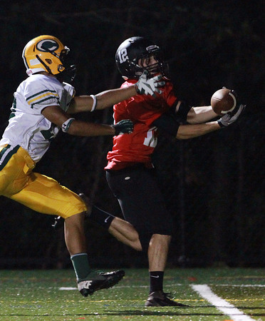 Marblehead: Marblehead senior Brian Daly hauls in a long pass from quarterback Matt Millett just past the outstretched hands of Lynn Classical defensive back Kenny Khun on Thursday evening. David Le/Salem News
