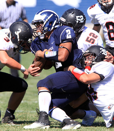 Swampscott: Swampscott senior running back Desmon Wilhelmsen (2) gets taken down by Marblehead junior Spencer Craig (3), senior Liam Gillis (52), and senior Ben Anderson for a loss of yards on Saturday afternoon. David Le/Salem News