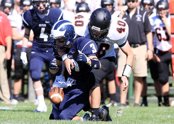 Swampscott: Marblehead sophomore Mark Cohen (40) breaks up a pass intended for Swampscott senior Tim Costin (3) to force a turnover on downs on Saturday afternoon. David Le/Salem News