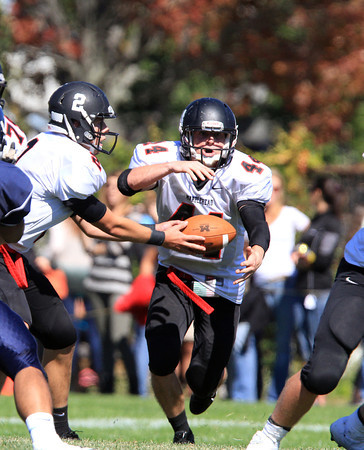 Swampscott: Marblehead junior running back Brooks Tyrrell (44) takes a handoff from senior quarterback Matt Millett (2) and has nothing but open running room ahead of him. Tyrrell paced the Magicians with 181 yards rushing and two scores to defeat rival Swampscott 35-7 on Saturday afternoon. David Le/Salem News