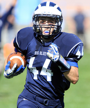 Swampscott: Swampscott senior Michael Faia outraces everyone to the end zone to score the lone Big Blue touchdown on Saturday afternoon against Marblehead. David Le/Salem News