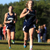 Hamilton: Hamilton-Wenham senior Emily Horgan, right, sprints ahead of her younger sister Olivia, left, a freshman, towards the finish line against Masco on Wednesday afternoon. David Le/Salem News
