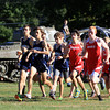 Hamilton: The Hamilton-Wenham and Masco boys rush out at the start of the race in a large pack on Wednesday afternoon. David Le/Salem News