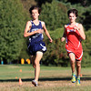 Hamilton: Hamilton-Wenham senior Matt Gillis, and Masco senior Harry Kent run side by side on Wednesday afternoon during their cross country meet at Patton Park. David Le/Salem News