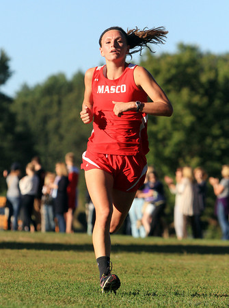 Hamilton: Masco senior Kathleen Gillespie sprints towards the finish line on Wednesday afternoon. David Le/Salem News