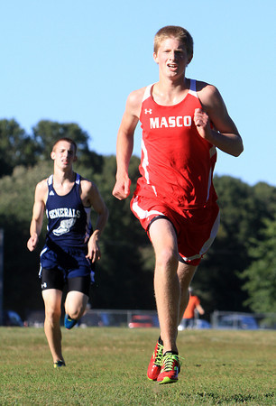 Hamilton: Masco freshman Kyle Faddis, right, outsprints Hamilton-Wenham's Jack Blatchford to the finish line of the boy's race on Wednesday afternoon. David Le/Salem News