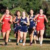 Hamilton: The lead pack of runners from Masco and Hamilton-Wenham stick together while running through the middle part of the course on Wednesday at Patton Park. David Le/Salem News