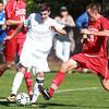 Danvers: St. John's Prep senior striker Matt Chilton, left, tries to keep possession of the ball while being pressured by Masco junior Kevin Gilbert. David Le/Salem News