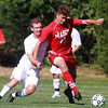 Danvers: Masco senior Jeffrey Panella, right, tries to shield St. John's Prep senior Liam Welch from the ball on Wednesday afternoon. David Le/Salem News