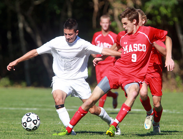 Danvers: St. John's Prep senior captain Anthony Vigliotta, left, shields Masco senior Dylan Zernich, right, from the ball as he controls play in midfield on Wednesday afternoon. David Le/Salem News