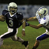 Peabody: Peabody running back Ryan Collins (3), tries to turn the corner while being chased down by Danvers defensive back Dan Lynch (6), on Friday evening. David Le/Salem News