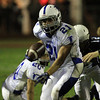Peabody: Danvers senior running back Alex Valles (21) breaks into the open field against Peabody on Friday evening. David Le/Salem News