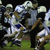 Peabody: Danvers junior Chris Behen (27) breaks through the Tanner defensive line and outraces everyone to the end zone for his second long touchdown run of the evening. David Le/Salem News