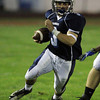 Peabody: Peabody junior Ryan Collins turns the corner against Somerville on Friday evening. David Le/Salem News