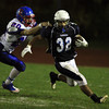 Peabody: Peabody sophomore Doug Santos evades a tackle from a Somerville defender on Friday evening. David Le/Salem News