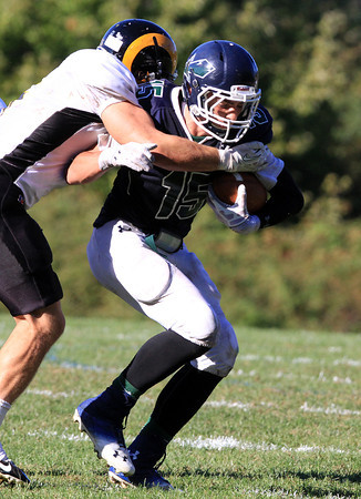 South Hamilton: Pingree sophomore Justin Assad drags a Tilton defender forward after catching a pass from quarterback Griffin Beal on Saturday afternoon. David Le/Salem News