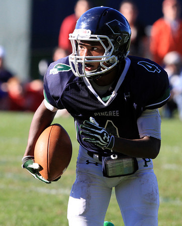 South Hamilton: Pingree senior captain Johnnie Spears breaks into the open field for one of his four touchdowns on the afternoon as Pingree cruised to a 52-14 win over Tilton. David Le/Salem News