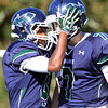 South Hamilton: Pingree senior captain Johnnie Spears (4) celebrates his long touchdown reception with sophomore quarterback Griffin Beal (7) on Saturday afternoon. David Le/Salem News