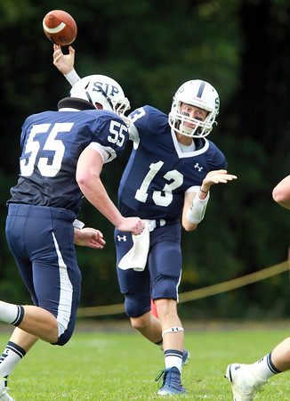 Danvers: St. John's Prep senior quarterback Michael Geaslen rifles a pass to junior tight end Jake Burt on Saturday afternoon against Brockton. David Le/Salem News