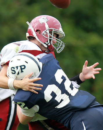 Danvers: St. John's Prep sophomore Jack Lambert (32) hits Brockton quarterback Patrick Burke square in the chest, and knocking the ball out of his hands. Eagles teammate Kent Blaeser recovered the fumble to stop the Boxers. David Le/Salem News