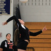Swampscott: Salem senior captain Hannah Mullarkey (5) smashes a spike over the net against Swampscott on Friday afternoon. David Le/Salem News