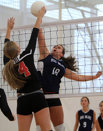 Swampscott: A Swampscott player (#18) gets her spike attempt blocked by Salem senior Julia Florence (4) on Friday afternoon. David Le/Salem News