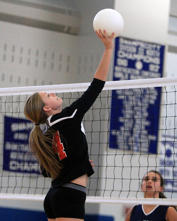 Swampscott: Salem senior Julia Florence leaps high in the air and tips the ball over the net against Swampscott on Friday afternoon. David Le/Salem News