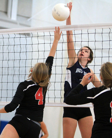 Swampscott: Swampscott senior Taylor Irwin (2) rises up to block a shot from Salem senior Julia Florence (4) on Friday afternoon during their match. David Le/Salem News