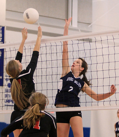 Swampscott: Swampscott's Taylor Irwin (2) tries to spike the ball over the outstretched hands of Salem's Julia Florence (4) on Friday afternoon. David Le/Salem News