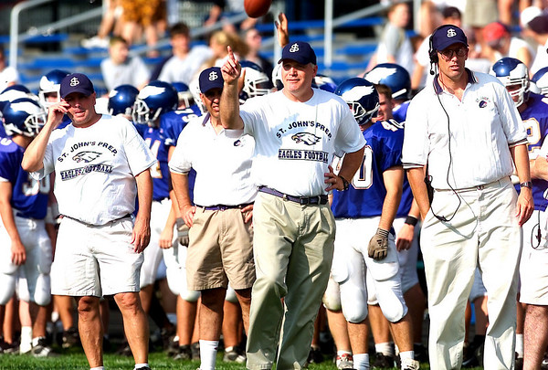 Danvers: Eagle coach, James O'leary, middle with his assistant coaches. (Photo by Jim Daly/Salem News). Saturday, November 23, 2002