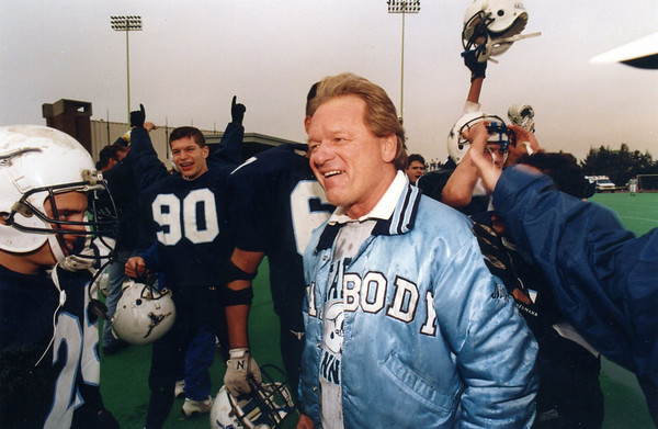 Coach Ed Nizwantowski — seen here celebrating perhaps his greatest victory, a 36-0 win over St. John's Prep in the 1993 Super Bowl — had a lot of success at Peabody High, including 174 career wins (the most in program history) and two Super Bowl titles.  Courtesy photo.