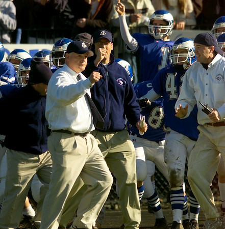 Danvers: Prep coach Jim O'Leary pumps his fist after converting a two-point conversion ini the fourth quarter to go ahead 22-21 on Thanksgiving day. (Photo by Jim Daly/Salem News). Thursday, November 27, 2003