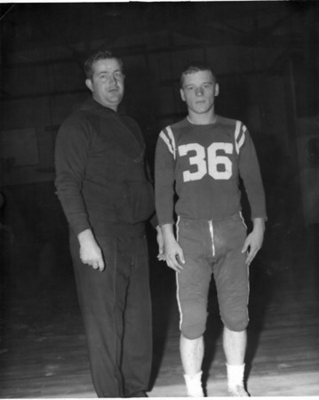 Ed Nizwantowski poses with predecessor and former coach Arthur Adamopoulos. Adamopoulos made our 11 Greatest Football Coaches in North Shore History list at No. 6.