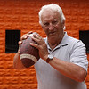 Beverly: Former Beverly High School Football coach, Bill Hamor, poses with a football at Hurd Stadium in Beverly .