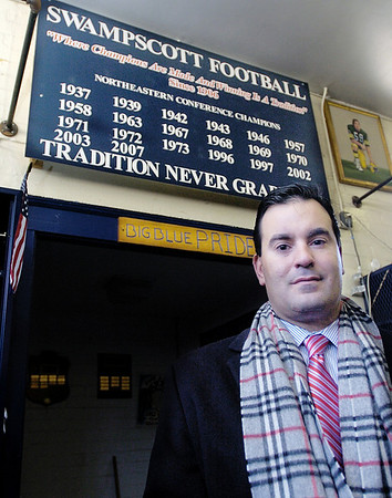 Swampscott: Swampscott football coach Steve Dembowski sits underneath a sign in the football locker room that notes the teams 20 Northeastern Conference championships in this 2008 photo.