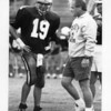 Peabody coach Ed Nizwantowski talks with quarterback Steve Lomasney, who led Peabody to back-to-back Super Bowl appearances in 1993-94 and later played in the Boston Red Sox organization.