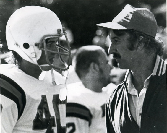 Former Beverly High School football coaching legend Bill Hamor talks with one of his players before sending him into the game. Courtesy Photo